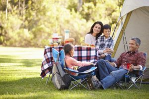 family enjoying camping