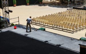 man cleaning the events stage