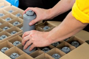 Packaging water bottles into a box