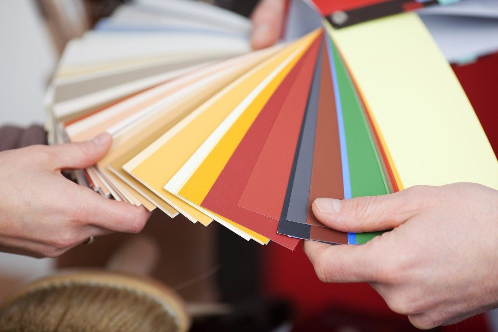 person choosing color swatches