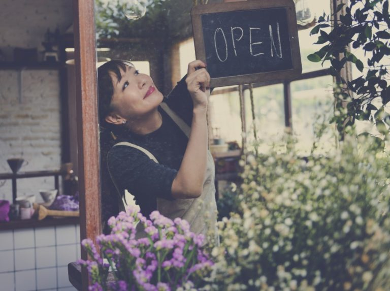 store owner opening her shop