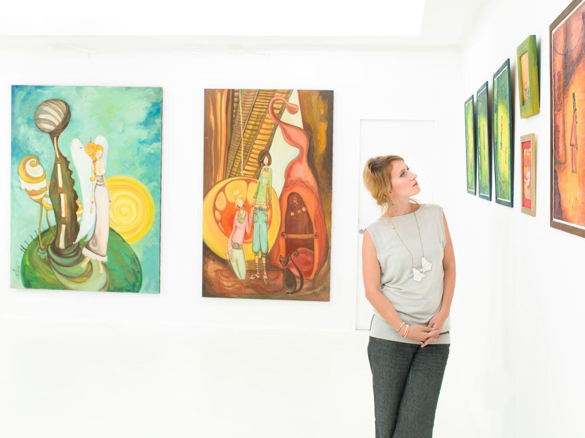 looking at paintings art gallery