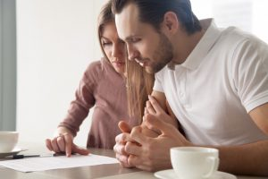 couple reviewing loan contract