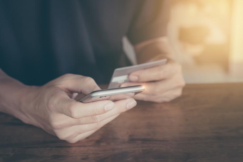 man online shopping through phone