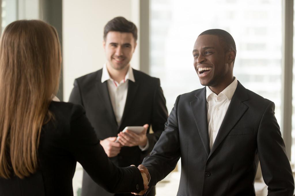 man being congratulated