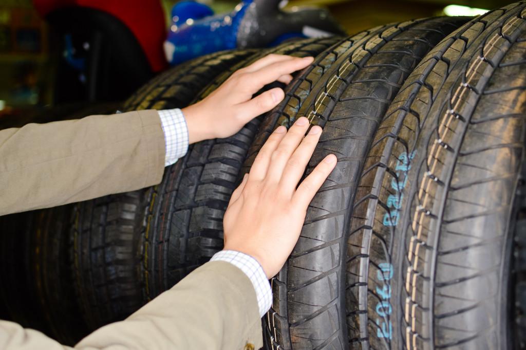 man choosing car tire